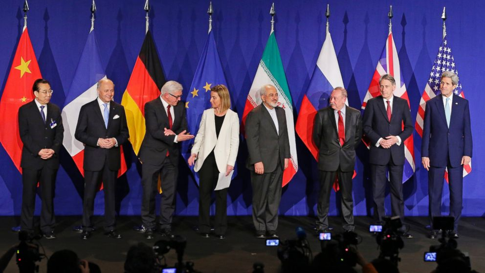 Iranian Foreign Minister and foreign ministers of major world powers stand for a photo after reaching a historic nuclear deal in 2015 that dropped sanctions in exchange for IAEA monitoring