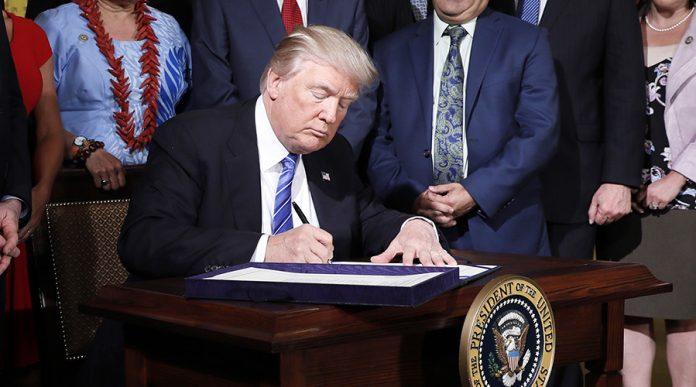 US President Donald J. Trump signing a bill