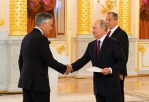 US Ambassador to Russia Jon Huntsman presents his credentials to Russian President Vladimir Putin. A top Russian diplomat said on October 11 that Moscow may demand further cuts to US diplomatic staff amid a row between the two nations.
