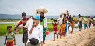 Rohingya families arrive at a UNHCR transit centre near the village of Anjuman Para, Cox's Bazar, south-east Bangladesh, on October 19 after spending four days stranded at the Myanmar border with some 6,800 refugees.