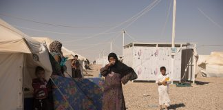 People from the town of Qaim outside their new homes in the Kilo 18 camp for displaced people from Anbar province in Iraq.