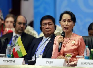 Aung San Suu Kyi speaks at a meeting of Asian and European foreign ministers in Myanmar