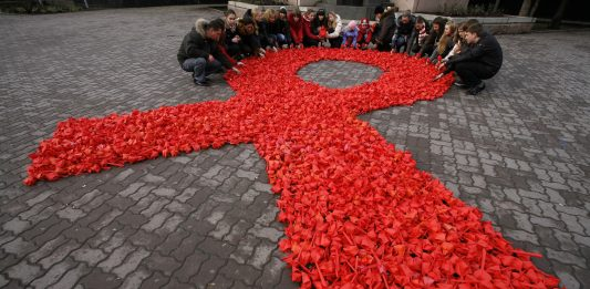 Activists in Russia hold an awareness campaign for HIV and AIDS