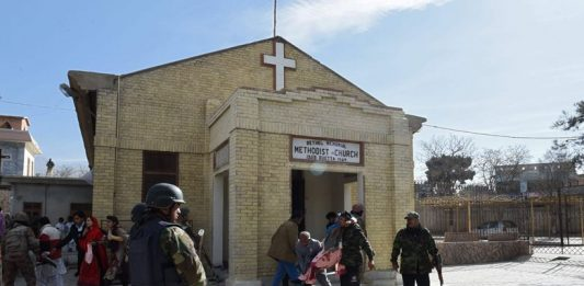 Pakistani security personnel near a church