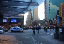 New York City police officers guard the subway near Times Square after a reported explosion