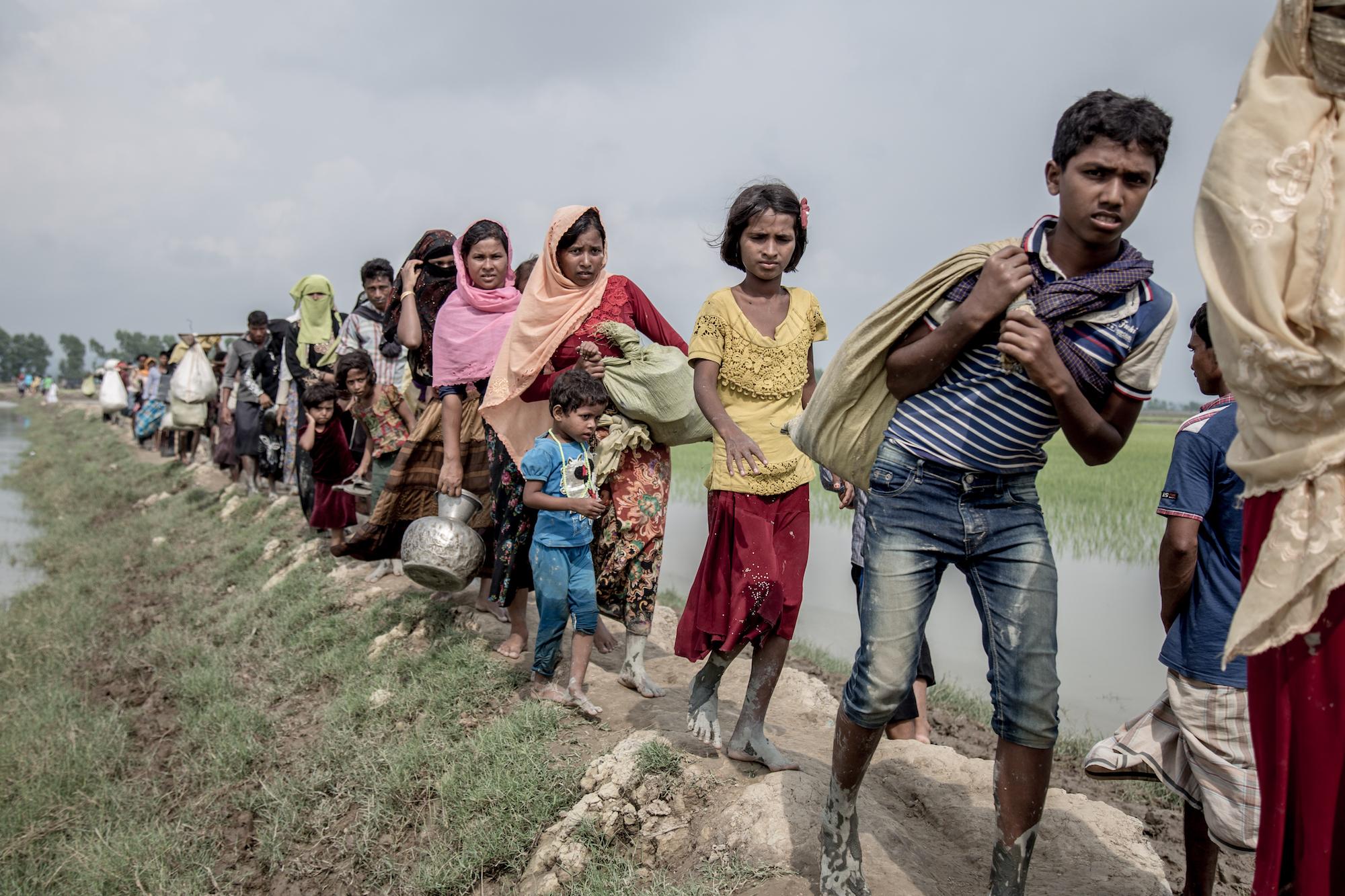 Rohingya refugees flee into Bangladesh