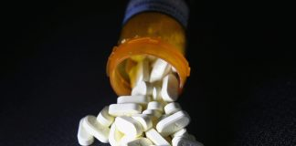 NORWICH, CT - MARCH 23: Oxycodone pain pills prescribed for a patient with chronic pain lie on display on March 23, 2016 in Norwich, CT. Communities nationwide are struggling with the unprecidented opioid pain pill and heroin addiction epidemic. On March 15, the U.S. Centers for Disease Control (CDC), announced guidelines for doctors to reduce the amount of opioid painkillers prescribed, in an effort to curb the epidemic. The CDC estimates that most new heroin addicts first became hooked on prescription pain medication before graduating to heroin, which is stronger and cheaper. (Photo by John Moore/Getty Images)