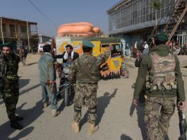 Afghan security personnel diverting people away from a U.S. base near Kabul
