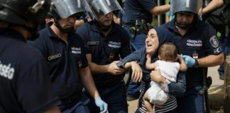 The arrest of migrants by police in Hungary