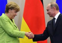 Merkel shaking hands with Putin in Sochi, Russia