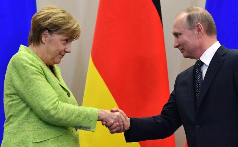 Merkel shaking hands with Putin in Sochi, Russia