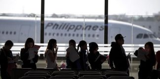 Workers from Philippines at an airport in Manila