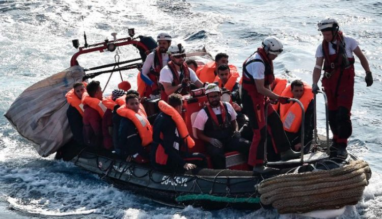 Migrants on a boat at sea