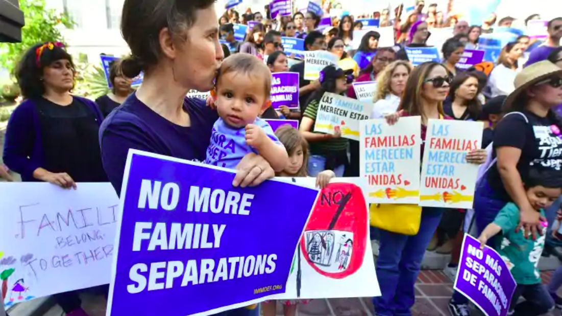 People gather on the steps of Los Angeles City Hall on Thursday to protest the federal government's policy of separating children from their parents trying to cross the U.S.-Mexico border illegally.
