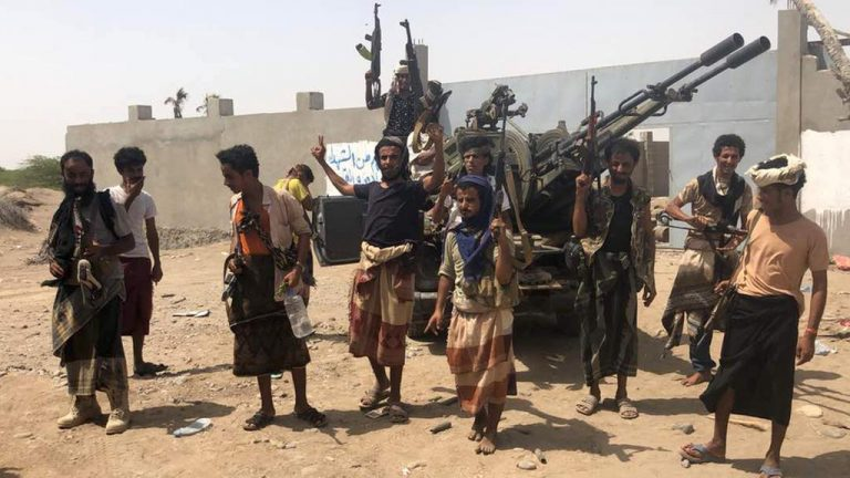 Yemeni pro-government forces gather during their fight against the Houthi rebels around Hodeidah's airport on June 18, 2018.
