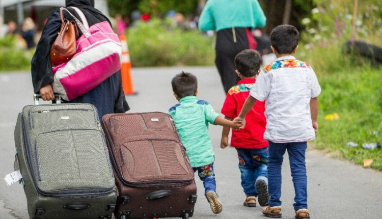 A family of asylum seekers heading towards the US-Canada border