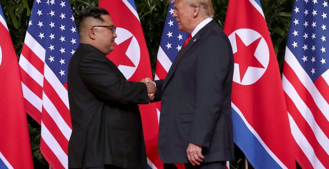 U.S. President Donald Trump shakes hands with North Korean leader Kim Jong-Un at the Capella Hotel on Sentosa island in Singapore June 12, 2018
