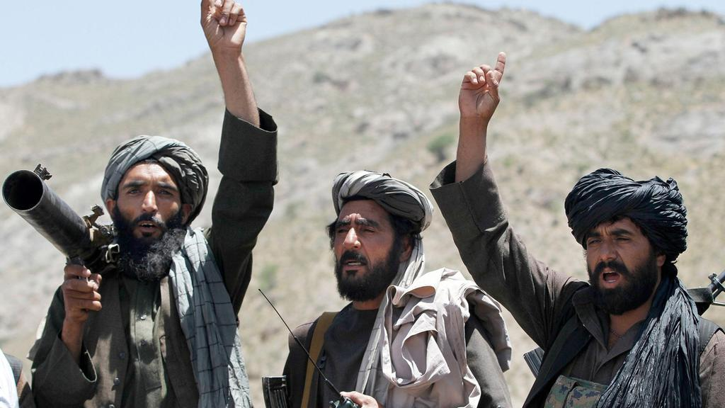 aliban fighters react to a speech by their senior leader in the Shindand district of Herat province, Afghanistan