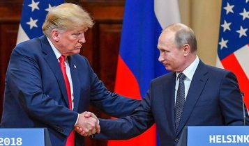 US President Donald Trump and Russian President Vladimir Putin shake hands at their meeting at Helsinki on July 16, 2018