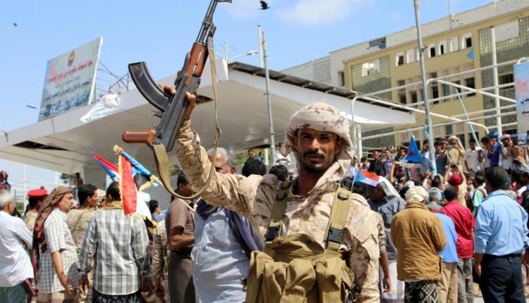 A southern Yemeni separatist fighter waves his rifle at the site of an anti-government protest in the port city of Aden, Yemen January 30, 2018.