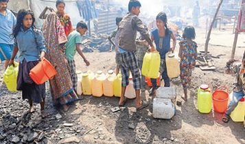 People in India with water canisters