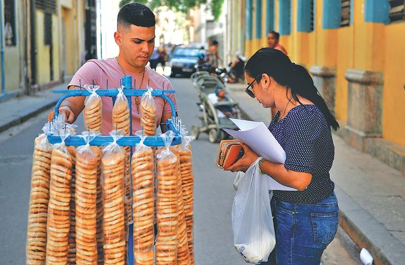 "An entrepreneur or ""cuentapropistas"" sells crackers in the streets of Havana, Cuba"