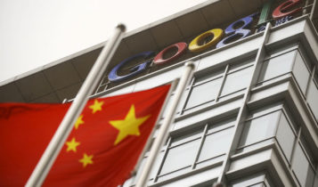 A Chinese flag wavers in front of a Google building.