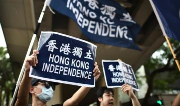 "Activists hold placards that read ""Hong Kong Independence"" as they take part in a protest march in Hong Kong on October 1, 2017."