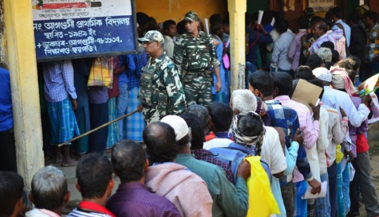 People lining up during a draft in India's Assam