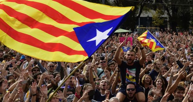Catalan pro-independence flags wave above a crowd during a protest in Barcelona, Catalonia