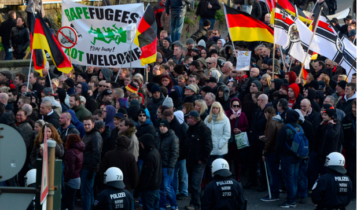 German far-right supporters demonstrate at Cologne`s train station on 9 January, 2016