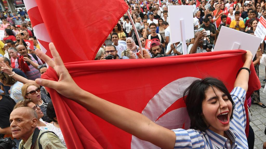 Women at a demonstration to mark Tunisia's Women's Day and to demand equal inheritance rights between men and women