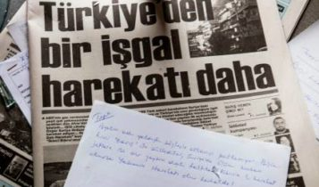 """A copy of the Turkish Cypriot """"Afrika Gazetesi"""" newspaper reading in Turkish """"One more occupation from Turkey"""" lying at its headquarters after they were broken into by protesters, in the northern part of Nicosia in the self-proclaimed Turkish Republic of Northern Cyprus"""