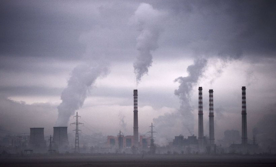 Smokes rising from stacks of a thermal power station, adding carbon dioxide (CO2) in the earth's atmosphere and contributing to global warming