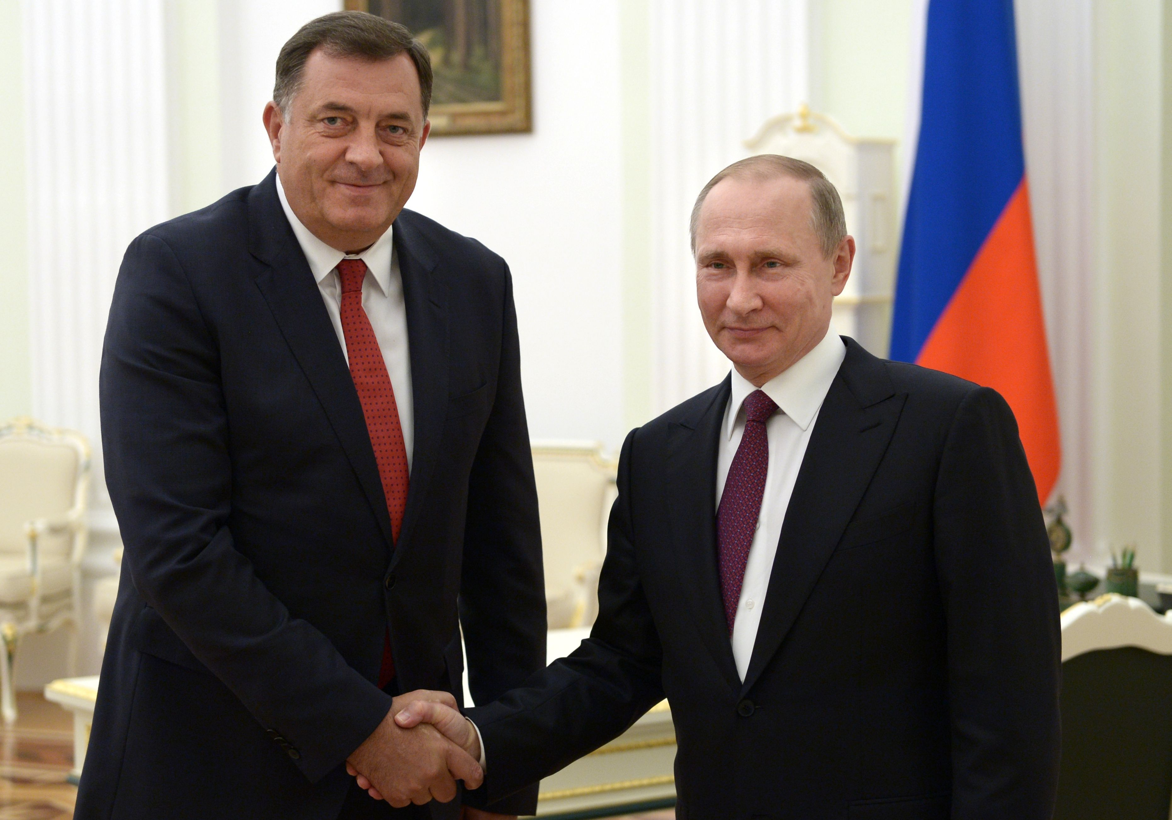 Russian President Vladimir Putin shakes hands with President of the Republika Srpska in Bosnia and Herzegovina Milorad Dodik during a meeting in Moscow in 2016.