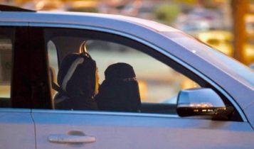 A Saudi woman sits in the driver's seat in Riyadh, Saudi Arabia