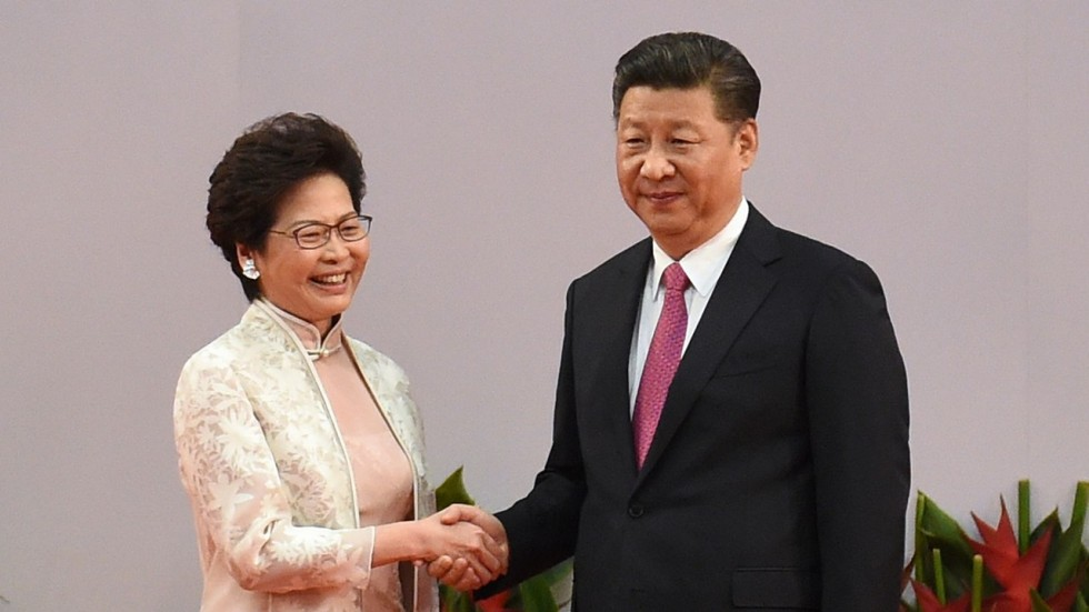 China President Xi Jinping shakes hands with Hong Kong's new Chief Executive Carrie Lam