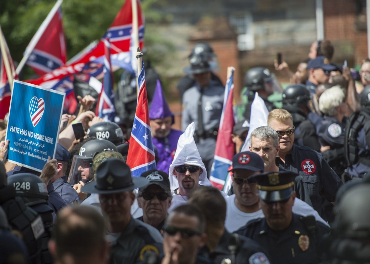 Members of the Ku Klux Klan arrive for a rally in Charlottesville, Virginia, on July 8