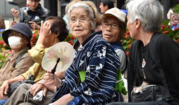 An old Japanese lady on a bench, representing the rapidly ageing popultion.