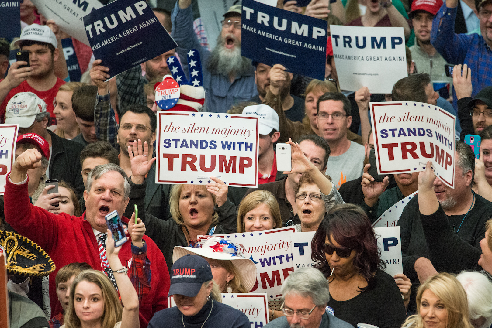 Donald Trump supporters cheer on the Republican presidential candidate before a campaign rally March 7, 2016 in Concord, North Carolina