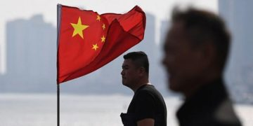 Two Chinese men and a flag
