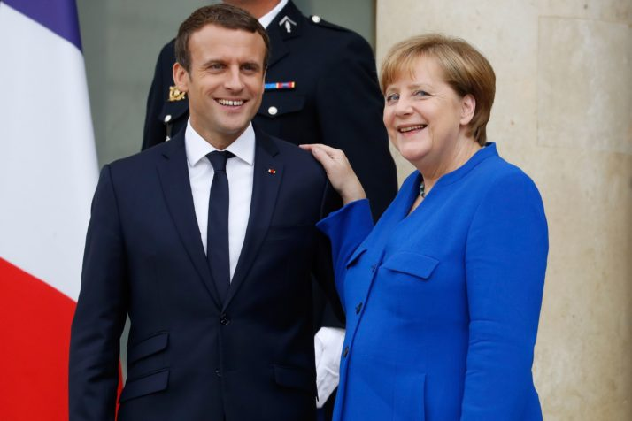 German Chancellor Angela Merkel (R) and French President Emmanuel Macron