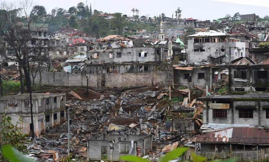 Destroyed buildings are seen from a government sniper's position on the front-line of the battle against Islamic State-linked militants in the Philippine city of Marawi