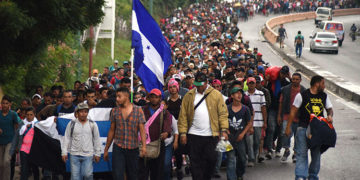 Honduran migrants take part in a caravan towards the United States in Chiquimula, Guatemala on October 17, 2018