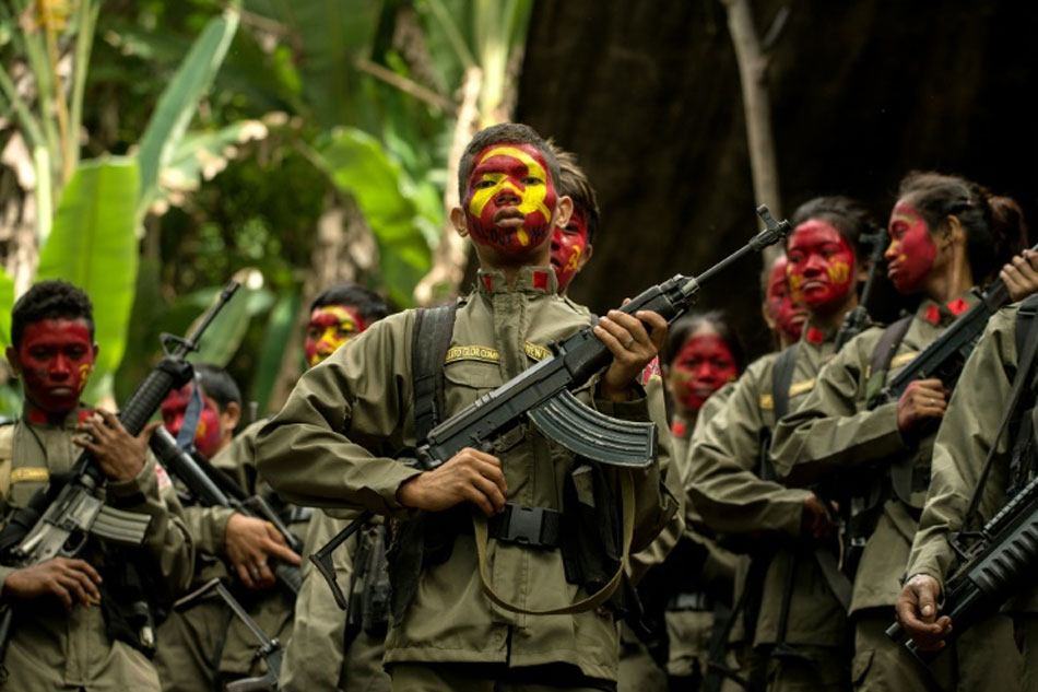 New People's Army (NPA) fighters in formation in the Sierra Madre mountain range east from Manila, Philippines