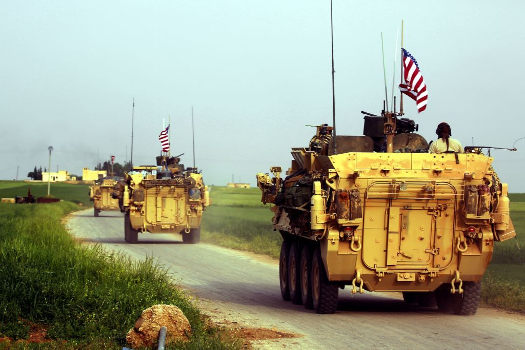 US forces, accompanied by Kurdish People's Protection Units (YPG) fighters, drive their armoured vehicles near the northern Syrian village of Darbasiyah, on the border with Turkey on April 28, 2017.