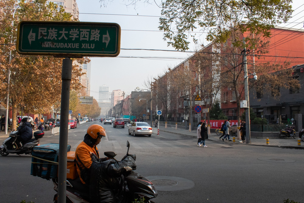 A food delivery worker on a street in Beijing