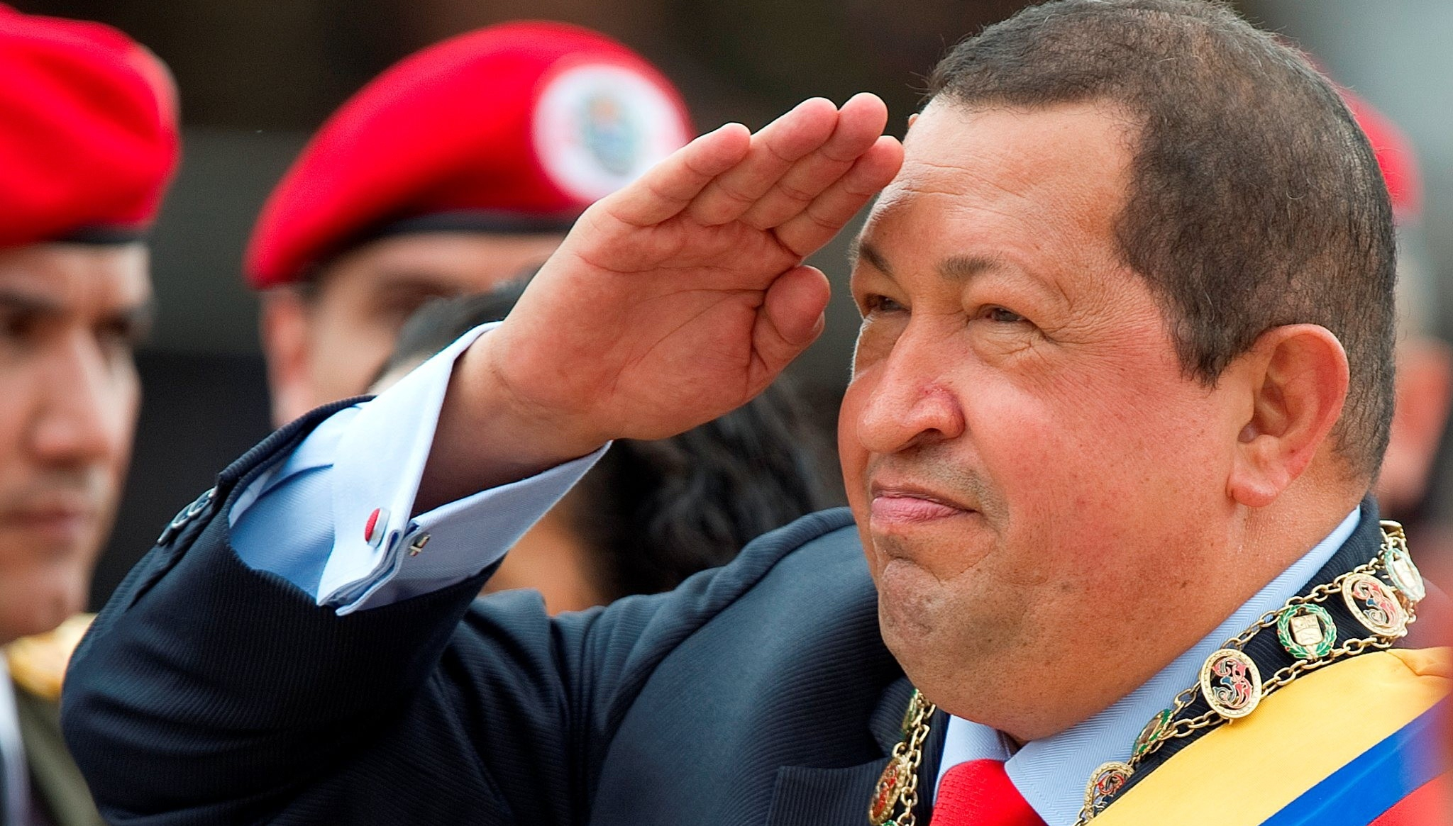 Venezuelan President Hugo Chavez salutes during a military parade to commemorate the 20th anniversary of his failed coup attempt, on February 4, 2012, in Caracas