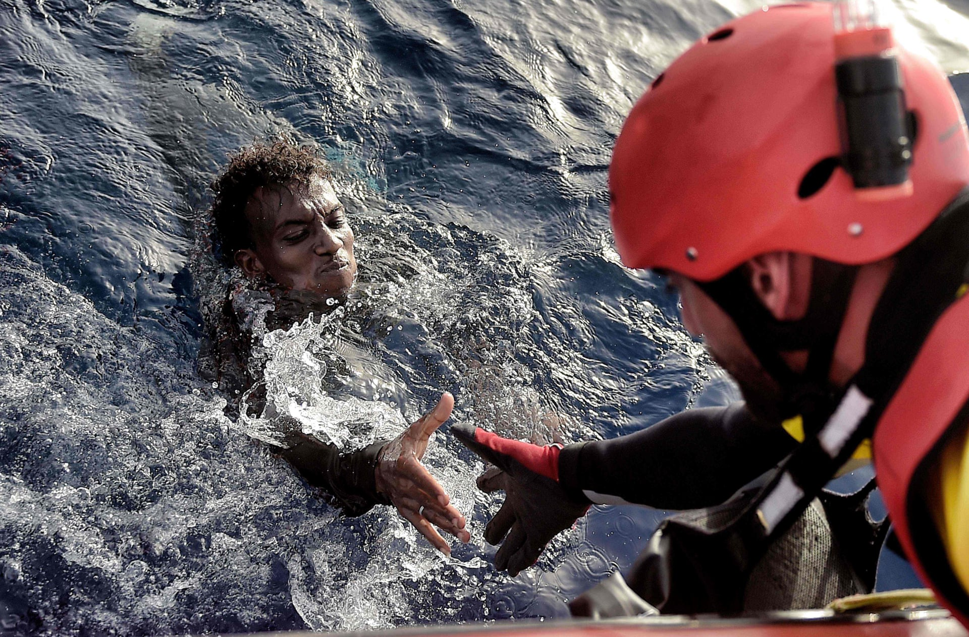 An African migrant is rescued from the Mediterranean sea