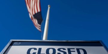 A sign is displayed on a government building that is closed because of the US government shutdown in Washington